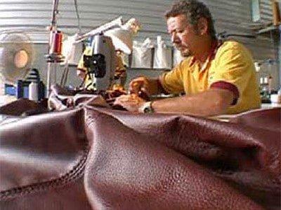 man-stitching-leather-sofa