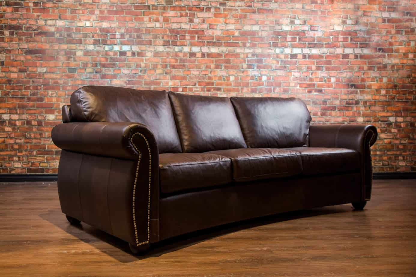 Denver curved sofa canada39s boss leather sofas and furniture for Leather sectional sofa denver